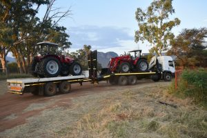 A picture that will make any farmer's heart race with joy: Two of Louis van der Walt's new Massey Ferguson tractors arrive at Spitskop Boerdery just before sunset.